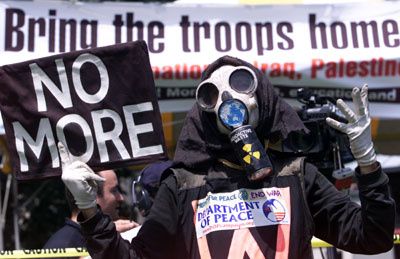 A anti-war protestor poses during a rally of A.N.S.W.E.R., the Coalition against War and Racism, at the Democratic National Convention in Boston, July 25, 2004. REUTERS/Marc Serota